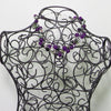 Tangled Glory necklace with purple beads.