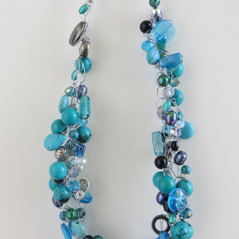 Tangled Glory genuine turquoise and mixed bead necklace close up.
