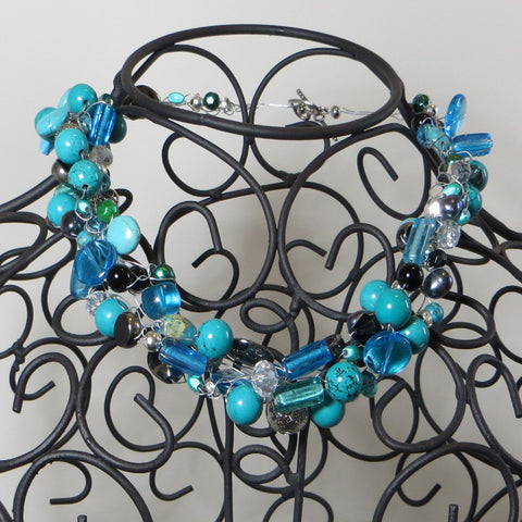 Tangled Glory genuine turquoise and mixed bead necklace on dress form.