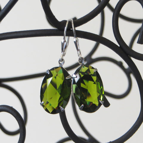 Winged Amour olive faceted jewel large earring.