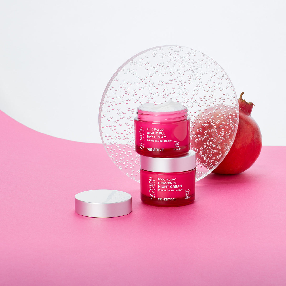 Andalou Naturals Sensitive 1000 Roses Beautiful Day Cream jars with a pomegrante
