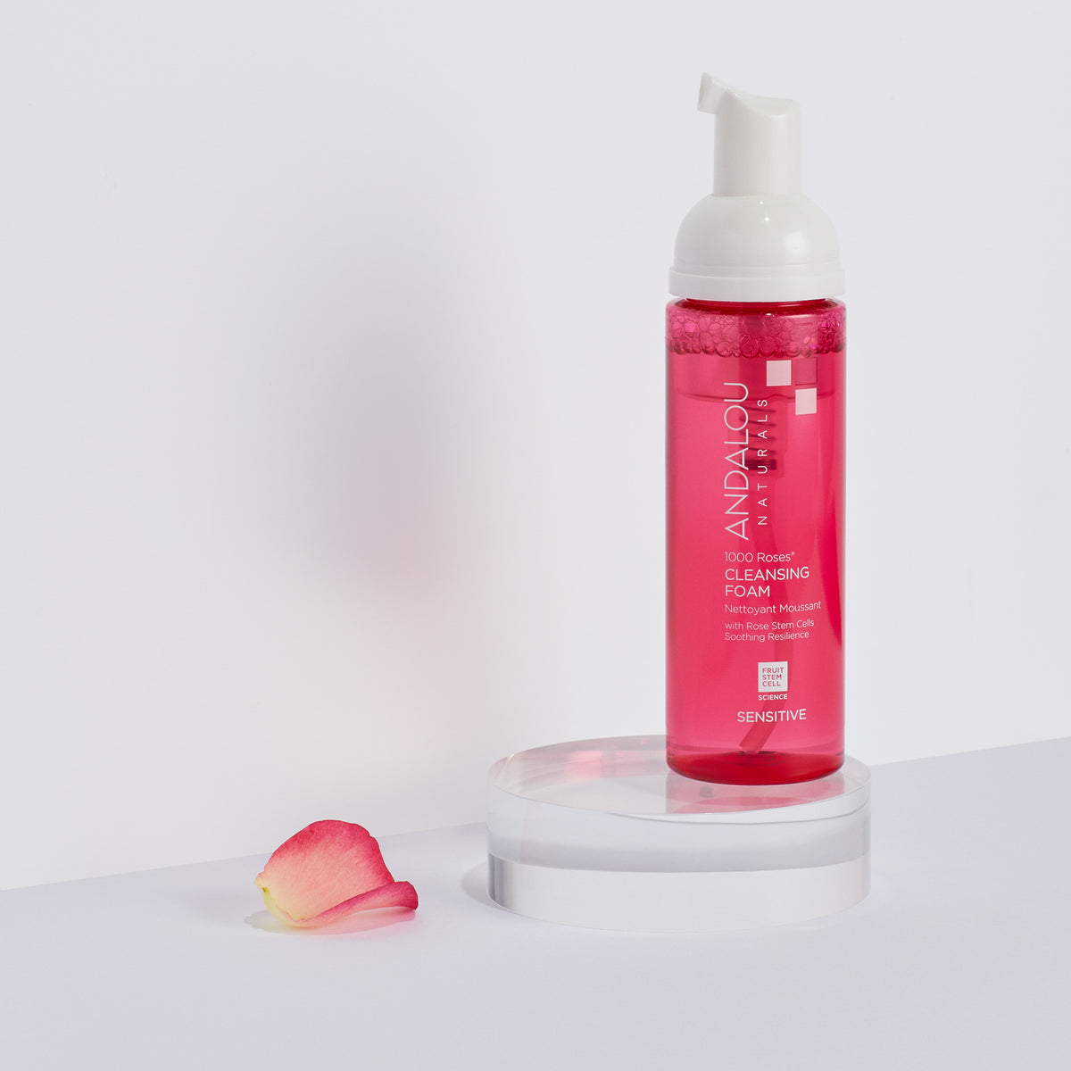 Andalou Naturals Sensitive 1000 Roses Cleansing Foam bottle with a rose petal