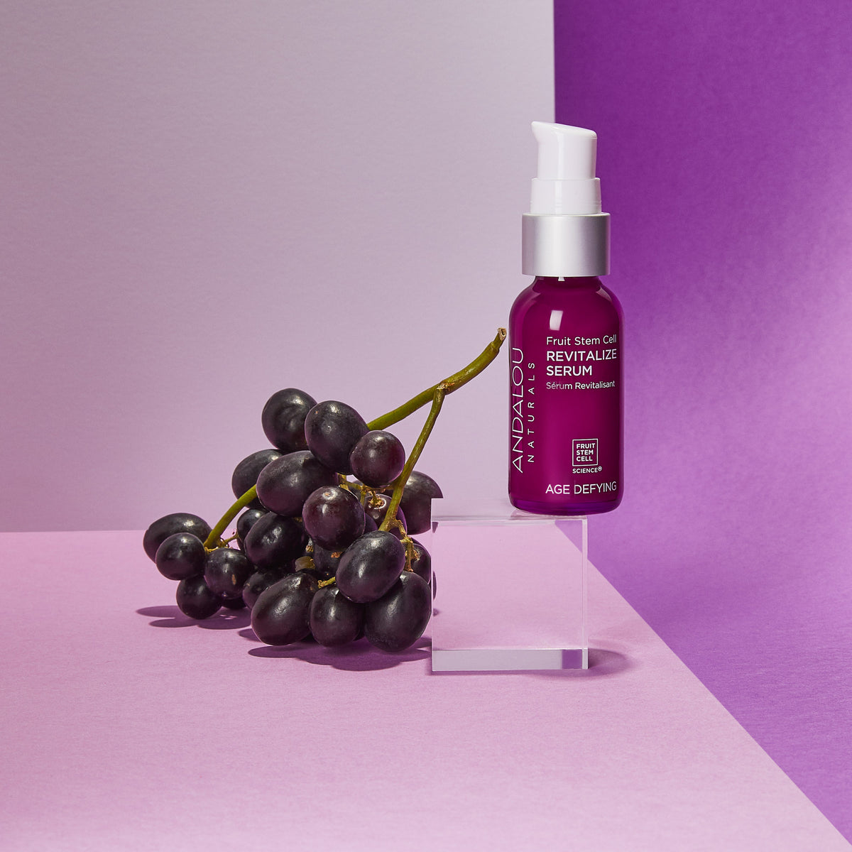 Age Defying Fruit Stem Cell Revitalize Serum bottle with concord grapes