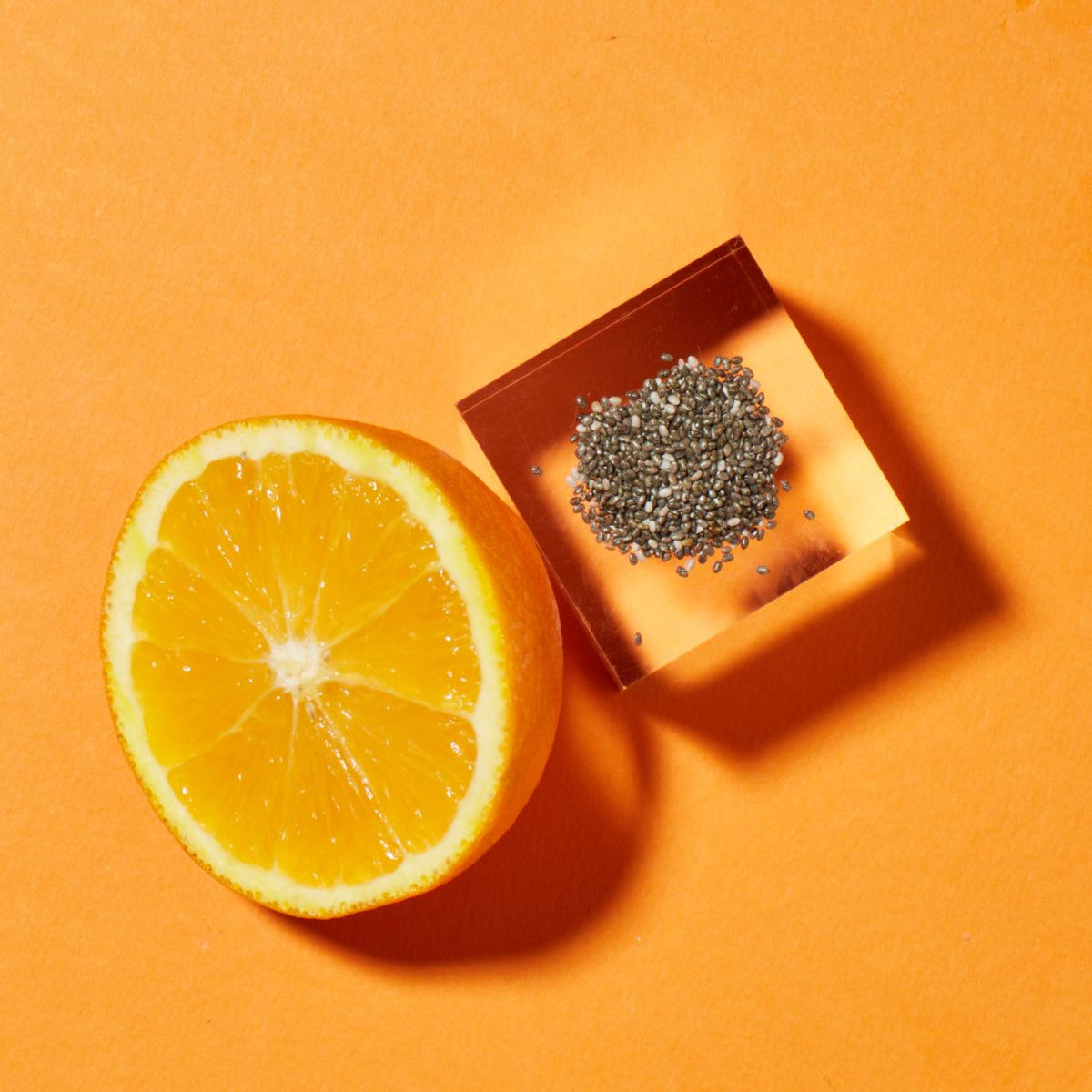 Chia seeds and half of an orange