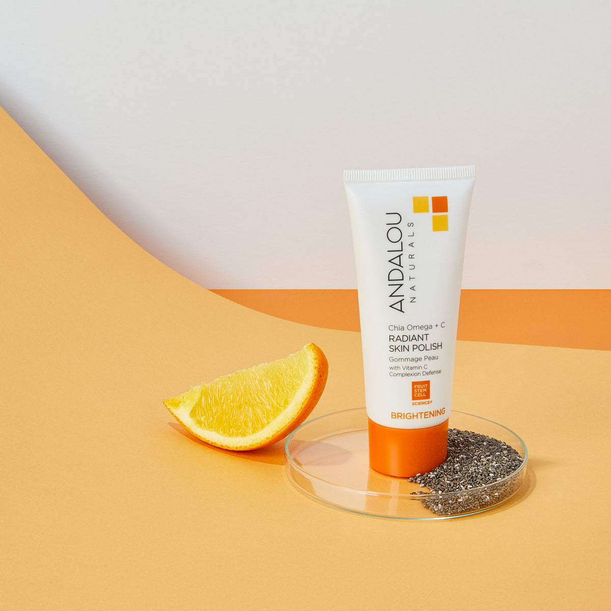 Andalou Naturals Brightening Chia Omega + C Radiant Skin Polish with chia seeds and orange slice