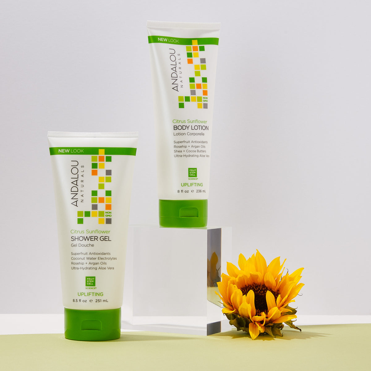 Andalou Naturals Citrus Sunflower Uplifting Shower Gel bottles with a sunflower