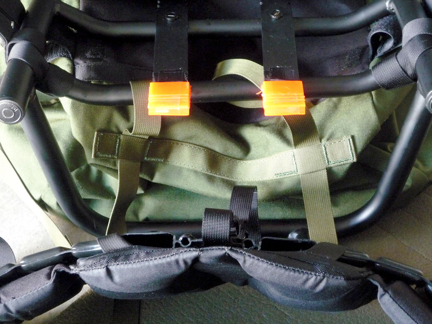 Elastromeric Shock Absorbers and their respective slots on the hip belt