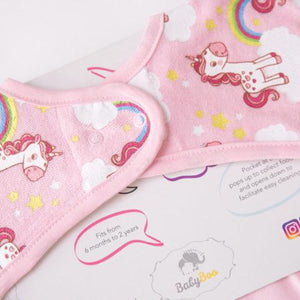pink feeding bib with unicorn design