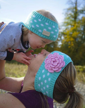 mother and daughter wearing matching headbands
