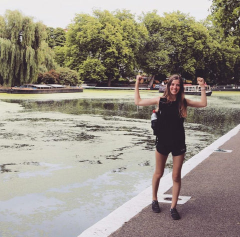 Claire stood by a canal