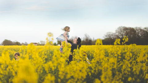 Sarah playing in a rapeseed field