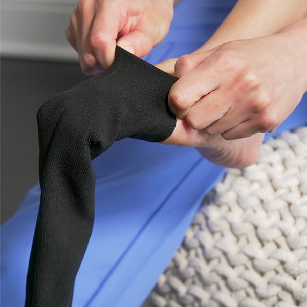 putting compression socks over toes