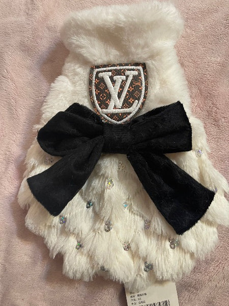 Elegant handmade white coat with black bow and Louis Vuitton inspired logo.