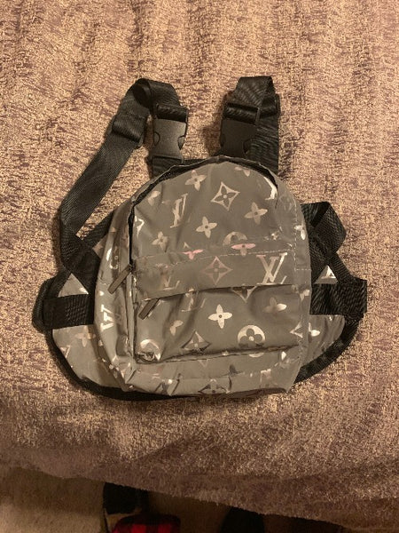 Grey reflective waterproof designer inspired backpack.