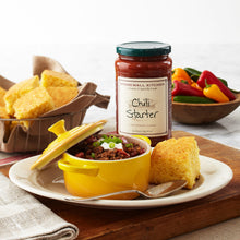 Load image into Gallery viewer, chili in a yellow crock with cornbread in a basket and a jar of Stonewall Kitchen Chili Starter
