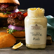 Load image into Gallery viewer, jar of Stonewall Kitchen Truffle Aioli in front of hamburgers with bacon, lettuce, and red onion