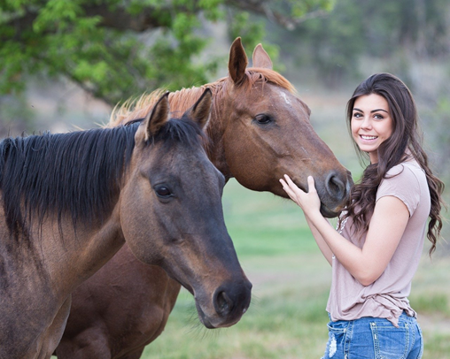 Two Horses and happy young Girl outdoor
