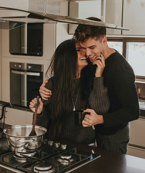 Couple happy while cooking their favorite meal together
