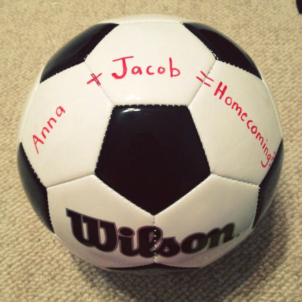 Homecoming proposal using a soccer ball