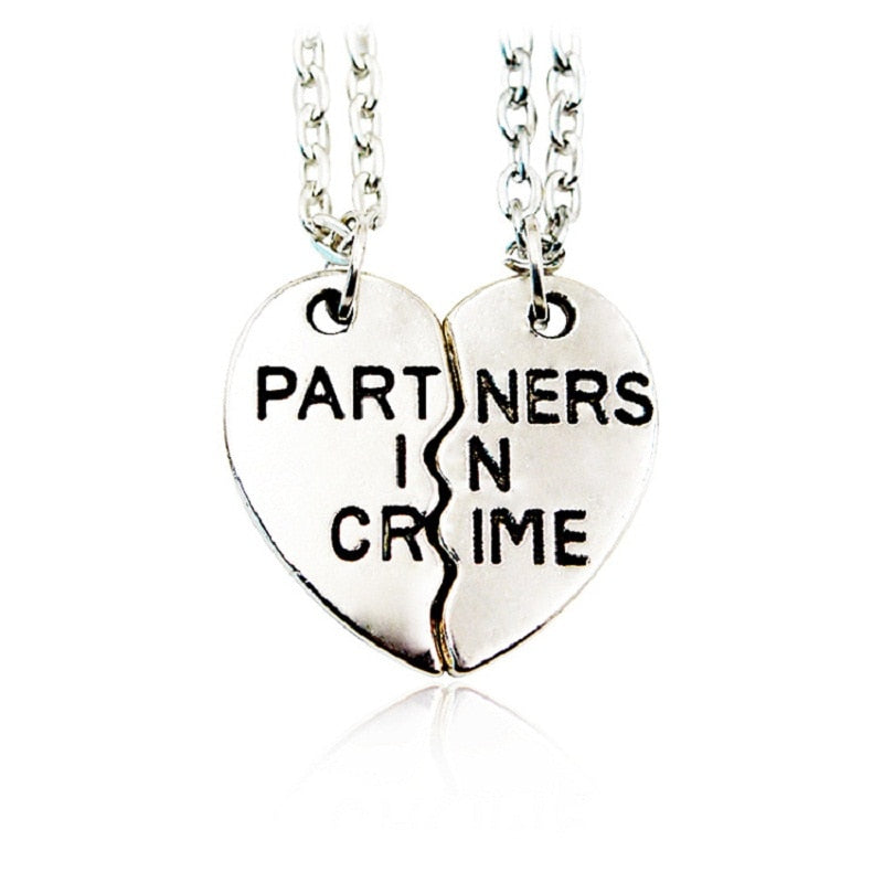 Partners-in-Crime-Heart-Necklaces.jpg