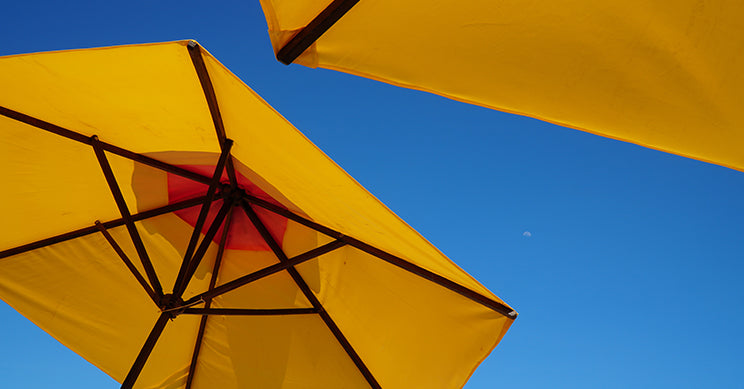 yellow umbrella with a blue sky