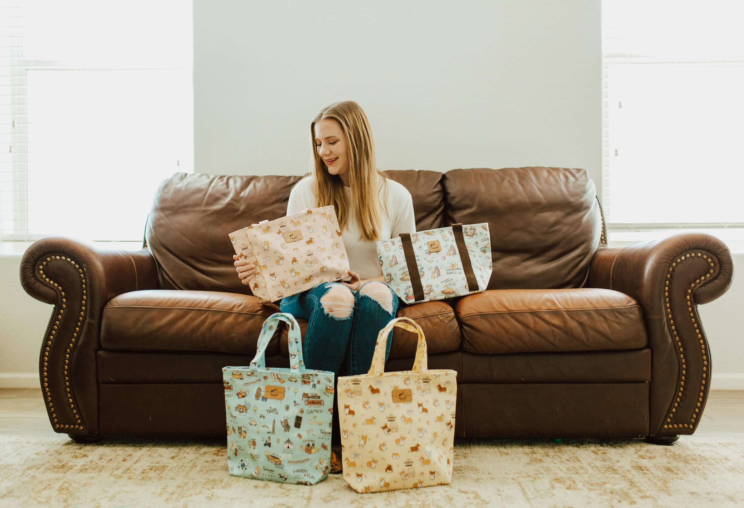 woman surrounded by Tworgis totes
