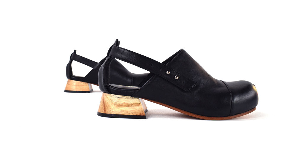 Profile view of the Betty Sandal in Black with wooden heel