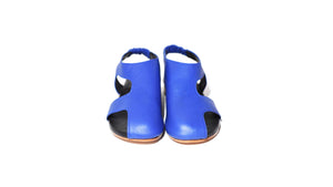 front view of Asymmetric bright blue leather sandal, covered toe, stacked leather heel