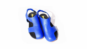 Asymmetric bright blue leather sandal, covered toe, stacked leather heel