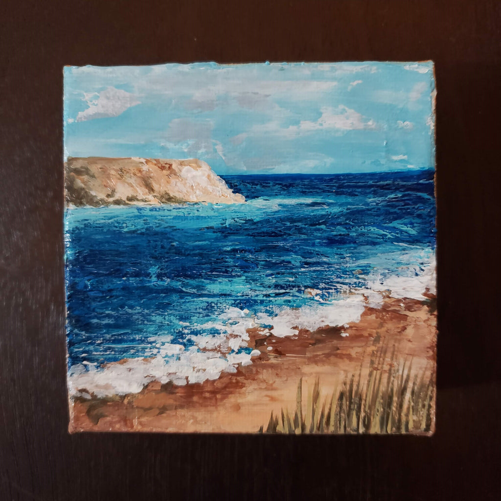 beach painting with cliff by kate shore