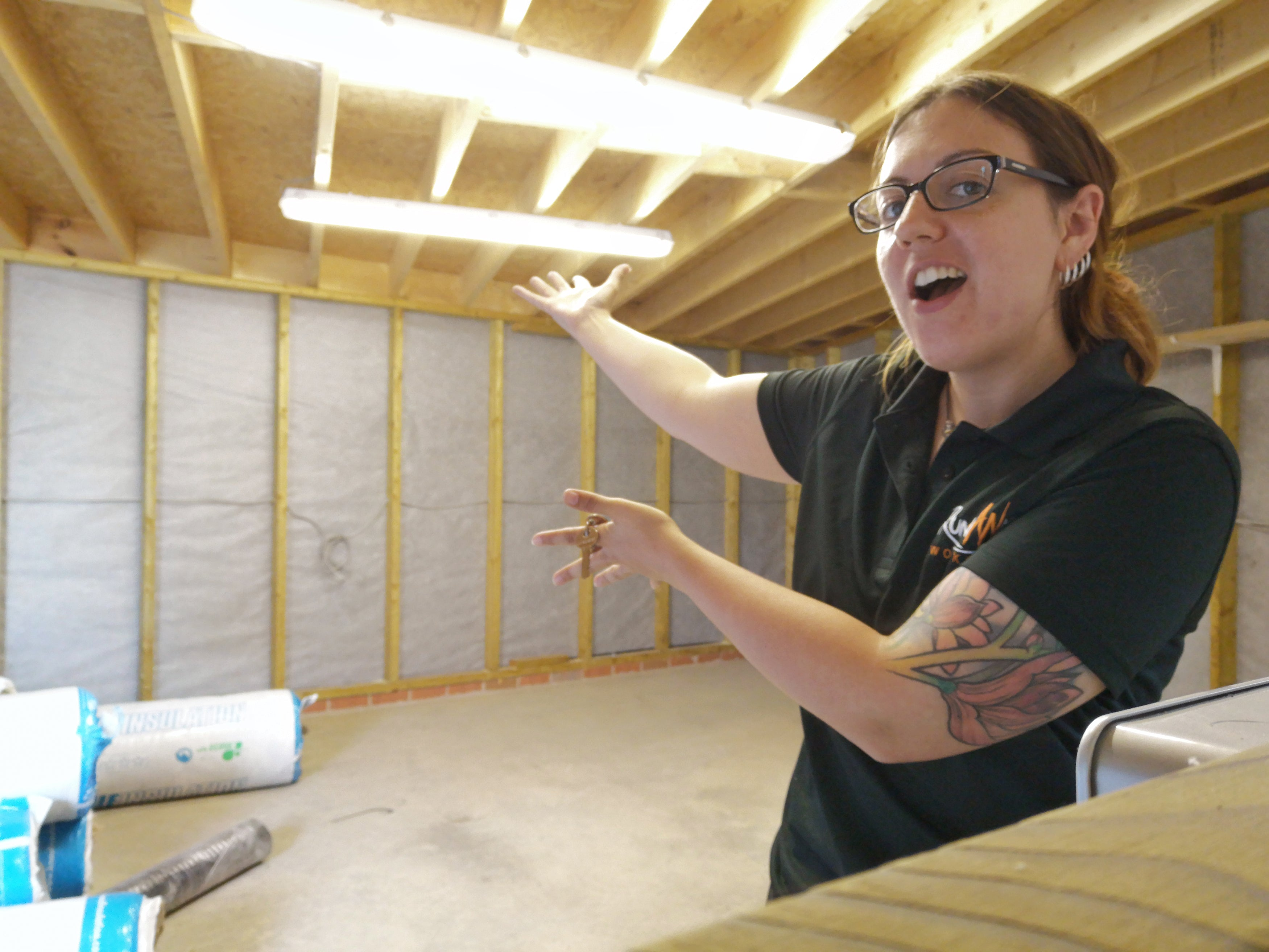a photo of me standing in my new workshop when it was still just a shed.