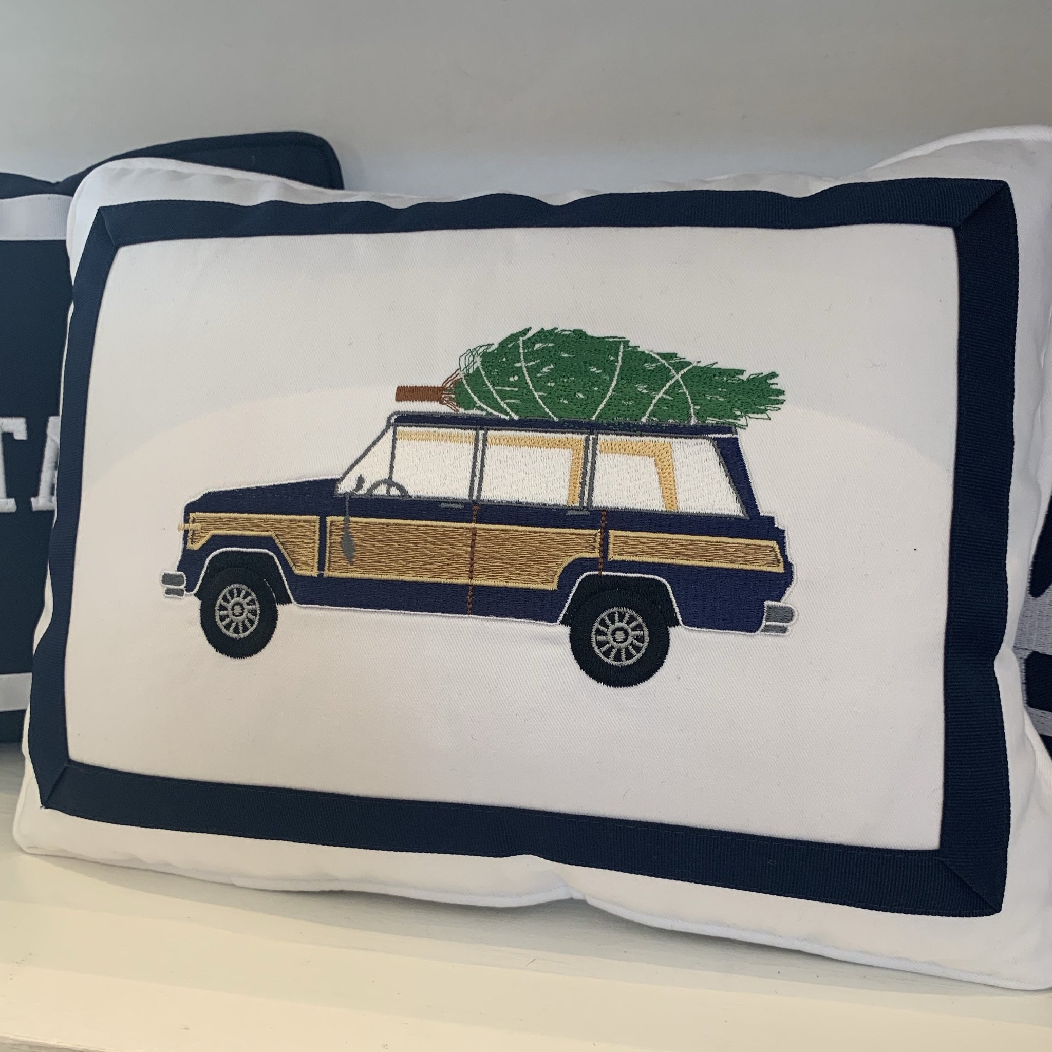 Navy Wagoneer on White Lumbar