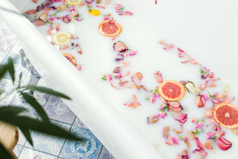 bath with fruit and flowers