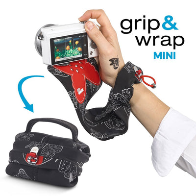 Serves as a camera grip (wrist strap) which morphs into a compact and padded camera