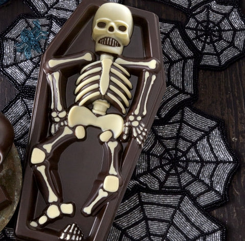 2.5 lbs, dark chocolate coffin featuring a dark and white chocolate skeleton