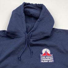 Load image into Gallery viewer, The Great TOmmy Sleep Out patch placed on a hoodie as an example of how you could use it.
