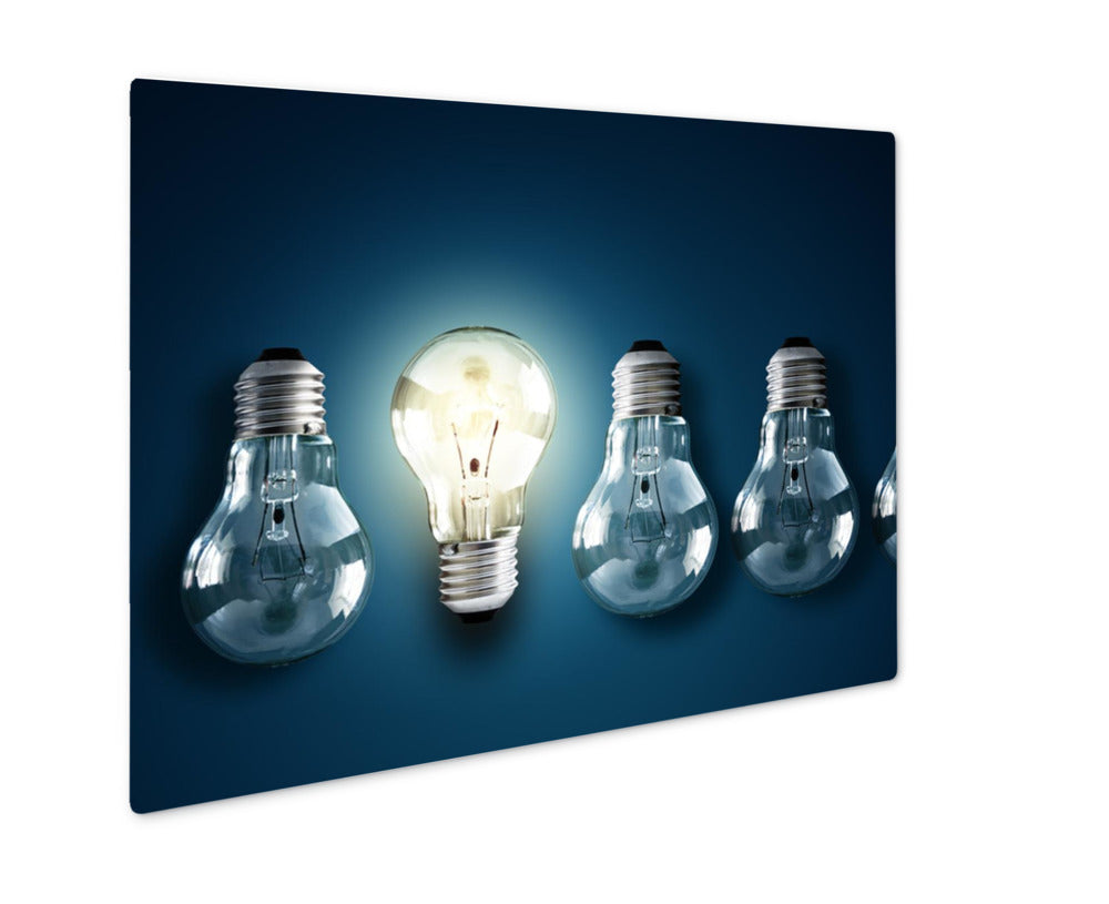 Illuminated Light Bulb In A Row Of Dim Ones Concept For Creativity Innovation Metal Panel Print