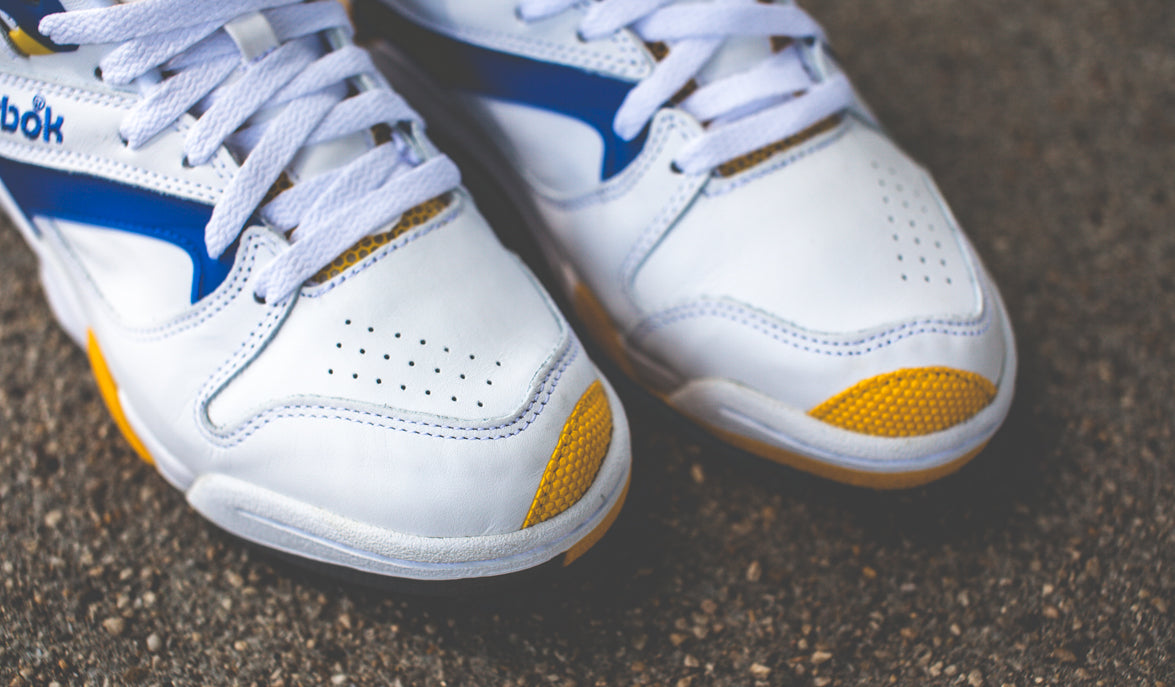37c6426c5e1 Reebok Court Victory Pump Color  White Ion Blue Yellow Style code  J14298  Price   125 USD
