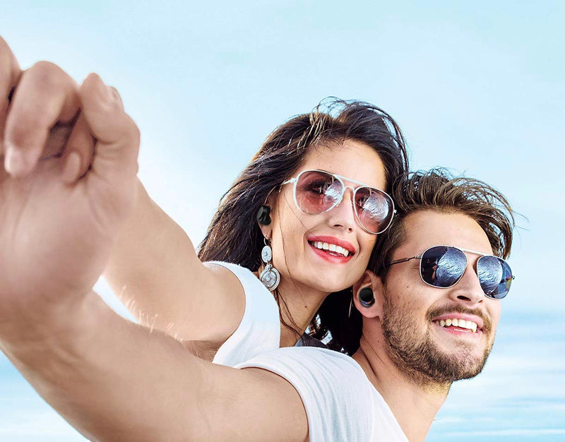 Woman and man with Vivid Sport Wireless Earbuds and sunglasses