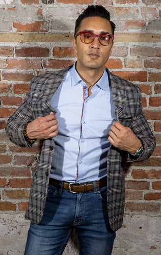 Tan plaid sport coat with blue accents. two button jacket, slim fit.