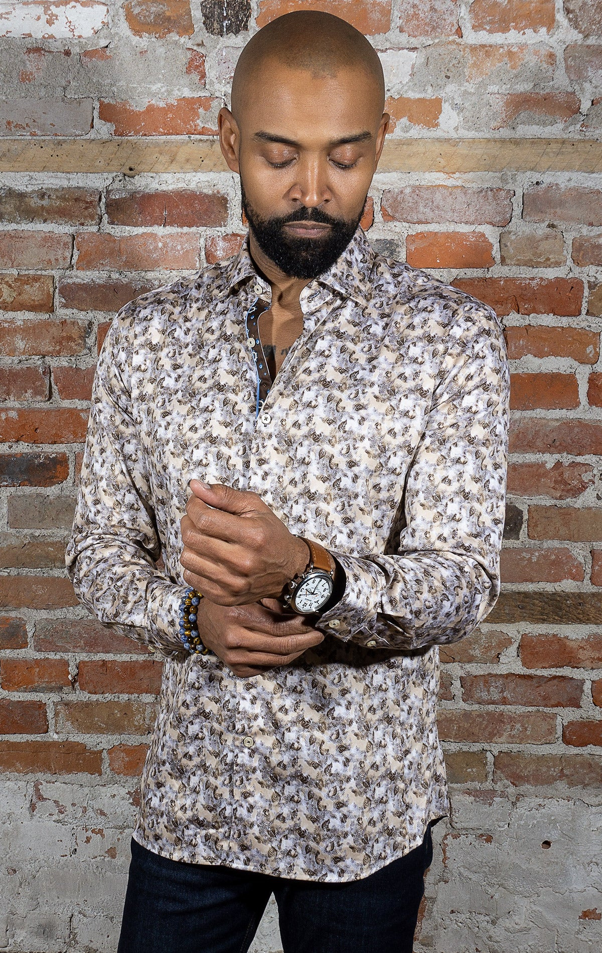 tan and brown long sleeve sport shirt. Leaf pattern