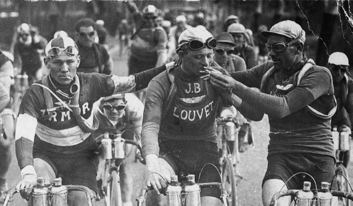 Old image of cyclist smoking during a race