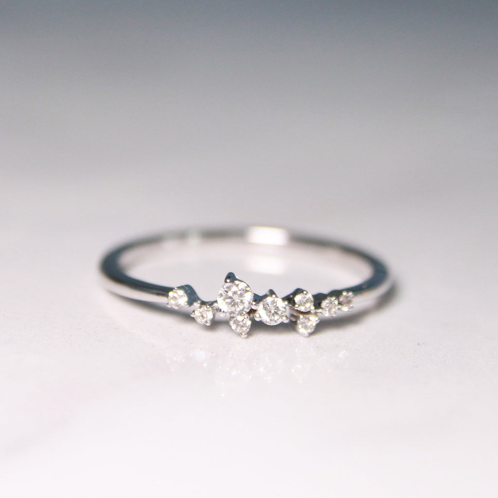 White Gold Scattered Natural Diamond Ring on flat surface