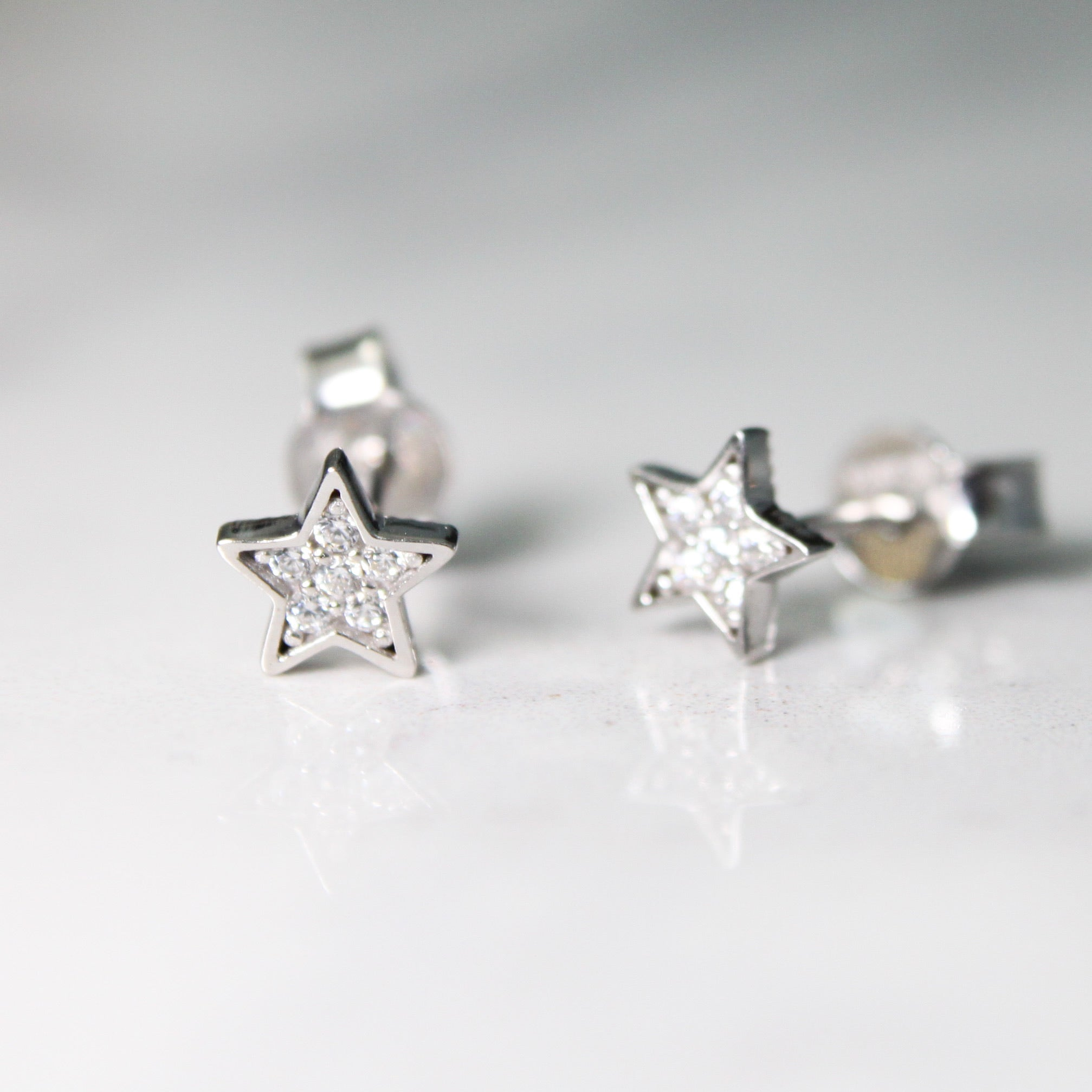 star earrings with cubics