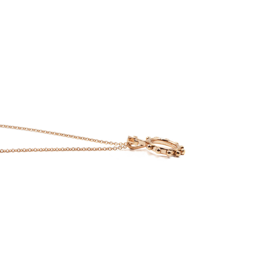 Side view of a Rosary Ring Necklace in Rose Gold
