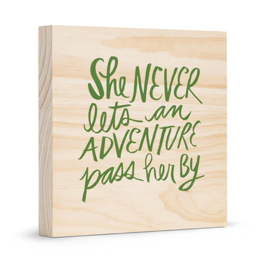Sign - She Never Lets an Adventure Pass Her By