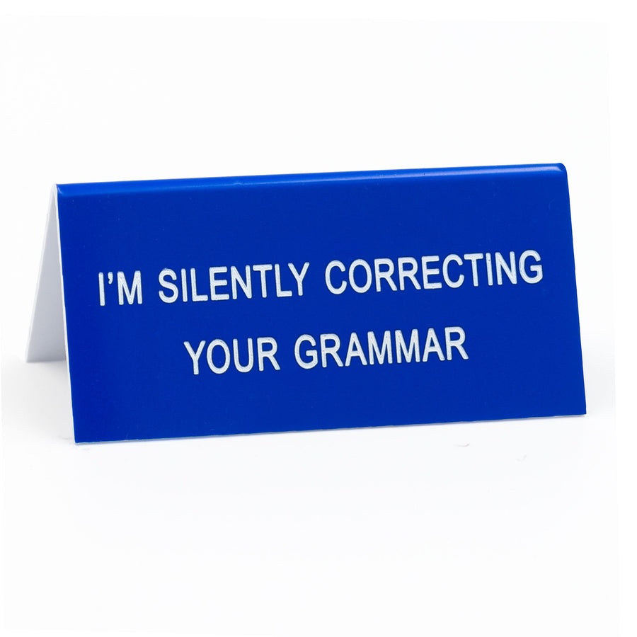 Silently Correcting Your Grammar Desk Sign