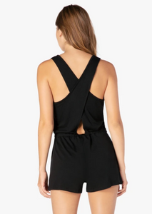 back of black romper with criss cross straps