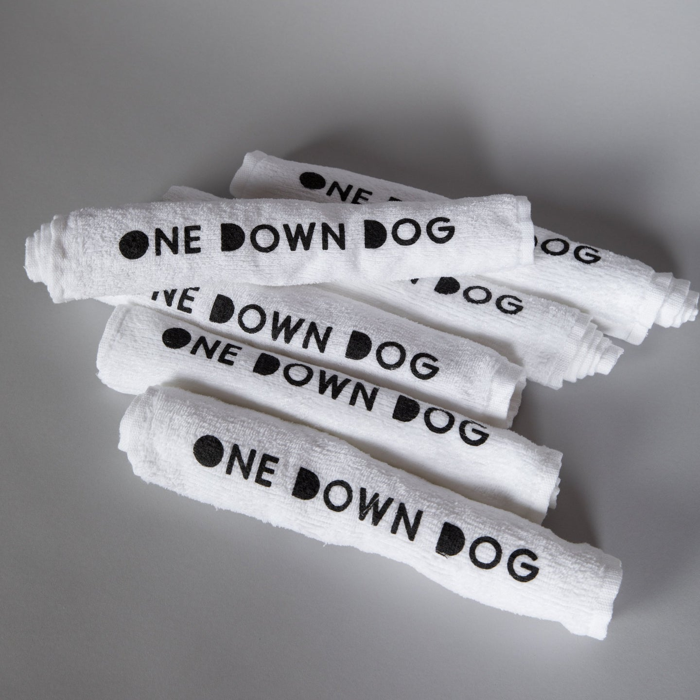 white hand towel with One Down Dog logo