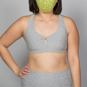silver mist colored sports bra with twist and cut out at center
